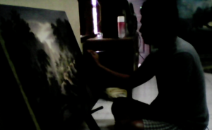 今回ご覧いただく新作の最後の仕上げを行う画家(バリ島のアトリエにて)